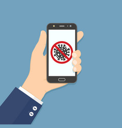 Hand holding smartphone with stop covid-19 sign vector