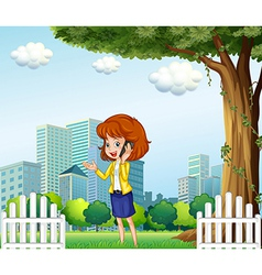 A lady using a cellular phone outside the office vector