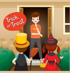 Trick or treat children and man open door vector