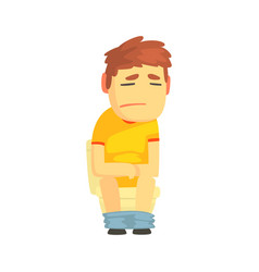 unhappy boy sitting on toilet suffering of vector image
