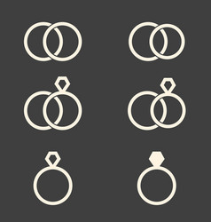 set of engagement rings icons on dark grey vector image