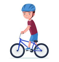 Boy riding a bmx bike vector