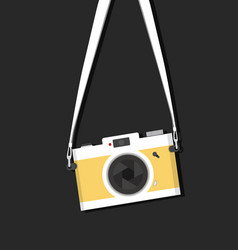 Hanging vintage camera with strap vector