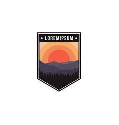 Patch emblem mountains and forest landscape vector