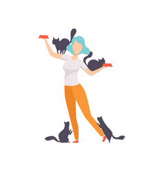 woman feeding her cats girl surrounded by black vector image