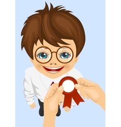 Somebody pins award ribbon to chest of schoolboy vector