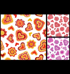 Seamless hand-drawn hearts patterns vector image
