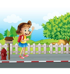 A cute little girl at the street beside the vector image vector image