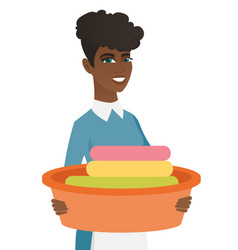 african housewife holding basin with dirty linen vector image