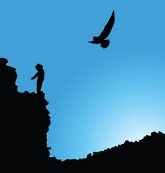 Boy on cliff with bird silhouette vector