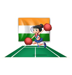 A cheerleader in front of the Indian flag vector image