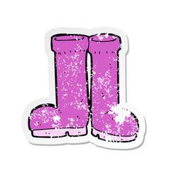 Retro distressed sticker of a cartoon rubber boots vector
