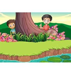 Two boys hiding at the tree vector image