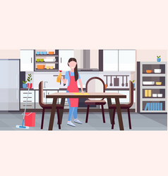 Housewife in apron wiping dinning table dust vector