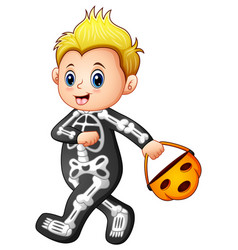 Boy in halloween skeleton costume with pumpkin bas vector