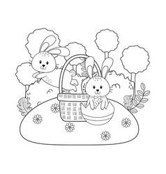 little rabbits in basket on the garden vector image