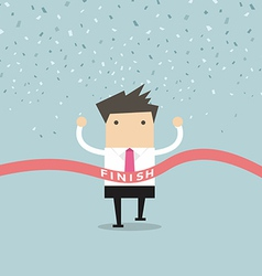 Businessman running success at the finish line vector image
