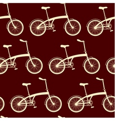 Seamless bicycles pattern on brown background vector