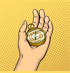 Compass in hand pop art vector