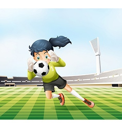 A female player catching the soccer ball vector image