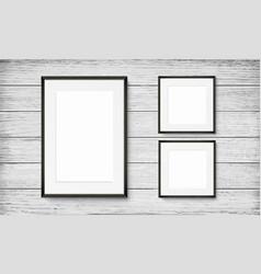 set black frames on wooden background vector image