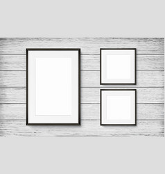 Set of black frames on wooden background vector