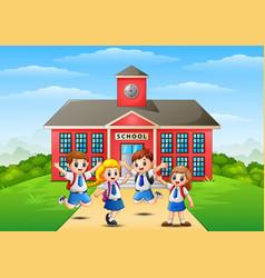 happy school children in front of school building vector image