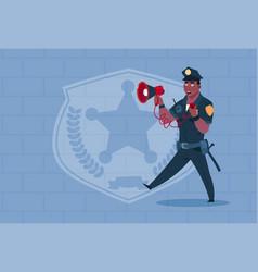 african american policeman hold megaphone wearing vector image vector image