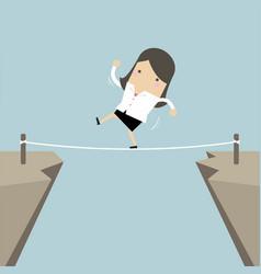 Businesswoman walk over cliff gap mountain vector
