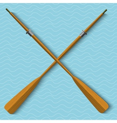 Two wooden oars on wavy background vector image vector image