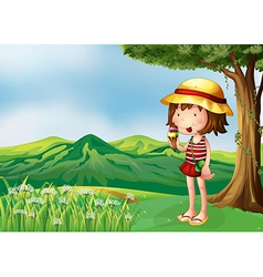 A girl eating an icecream at the top of the hills vector image vector image