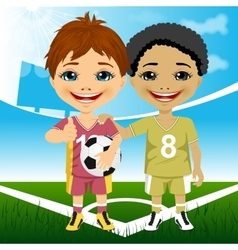 Two cute multiracial youth soccer players vector image