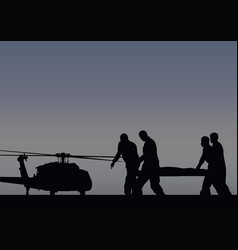 soldiers with the wounded go to the helicopter vector image vector image