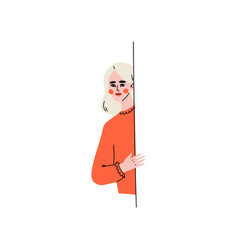 Young blonde woman peeping from behind wall vector