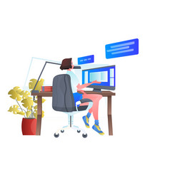 woman sitting at workplace and using computer chat vector image