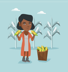 Young african farmer collecting corn harvest vector