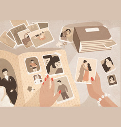 Woman s hands holding old photographs sorting vector