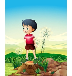A little boy standing above the stump vector