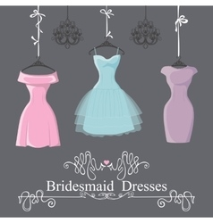 Three short bridesmaid dresses hang on ribbons vector