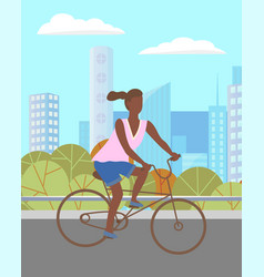 woman riding a bicycle in green summer park vector image