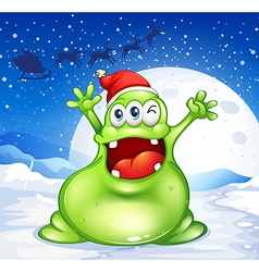 A fat green monster wearing a red Santa hat vector