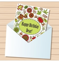 happy birthday dear card in envelope on wooden vector image