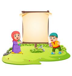 Two children are standing in green garden vector