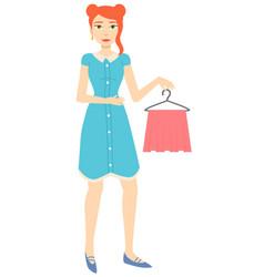 Girl holding pink skirt on hanger image vector