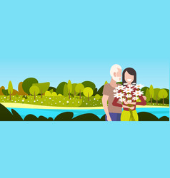 happy mature couple with flowers standing together vector image