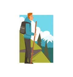 man hiking in mountains with backpack and staff vector image