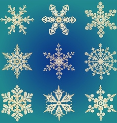 Set hand-drawn doodles gold colored snowflake vector