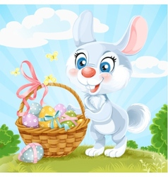 Easter Bunny with basket of eggs on the green lawn vector image