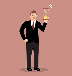 Businessman holding sandglass vector image vector image