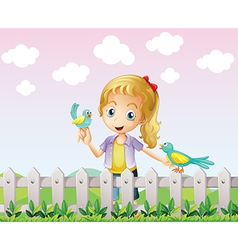 A girl with two birds near the wooden fence vector image